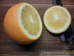 Фруктовый салат в апельсине: Отрезать шапку апельсина, примерно 2 см.
